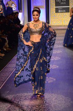 An indigo blue tulle saree with zardosi and thread embroidery.