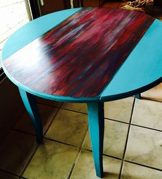 Sante Fe mojo My turquoise chalk painted drop leaf table featuring the fabulous Unicorn Spit Gel Stain. I used DIY chalky paint on the base, and a blend of teal, red, and blue stain on the center section. Paint Furniture, Furniture Projects, Furniture Makeover, Wood Projects, Unicorn Spit Stain, Cabinet Door Makeover, Glass Fish Bowl, Paint Drop, Drop Leaf Table