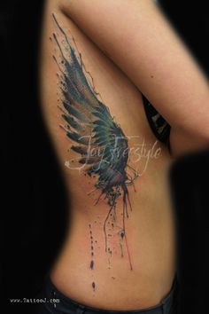 Awesome watercolor one wing tattoo by Jay Freestyle
