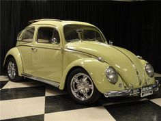 1961 VOLKSWAGEN BEETLE CUSTOM 2 DOOR RAG TOP - 1915cc, 4 cylinder from Bugformance. Weber 44 dual carburetors, remote oil filter, adjustable lowered front beam. Compufire electronic ignition module, rebuilt tansaxle with close ratio first gear and heavy duty side plate, Kenedy clutch, KYB shocks, 4-wheel disc brakes, huge subwoofer and amp with iPod connection. Custom wheels with new Nitto tires, lowered suspension, roller throttle pedal, Serpentine belt and Parcel Tray Clifford alarm.