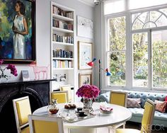 The combo dining room and library in this renovated London townhouse pulls off a design full of bright, welcoming colors and fun accessories, without veering toward childish. Tour the rest of the home. Home Design, Cat Design, Interior Inspiration, Room Inspiration, Colour Inspiration, Interior Ideas, London Townhouse, London Apartment, Elle Decor