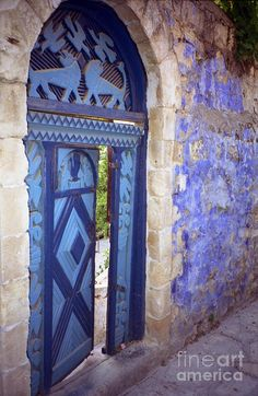 Doors of Safed (or Zvat) in the Galilee. in this holy town, things are painted blue so that when the devil comes up out of hell, he sees the blue, thinks he's in heaven, and goes back down! at least that's what my daughter tells me after her trip to Zvat last month.
