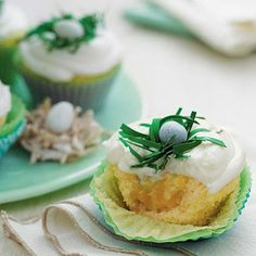 Pineapple-Coconut Cupcakes with Buttermilk-Cream Cheese Frosting | Make birds' nests with malted milk balls and edible paper; wilton.com | SouthernLiving.com
