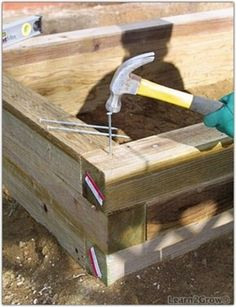 Garden beds using 4-by-4s with no need for corner posts. Hmm I need to glean a few more pallets with 4x4 centers.