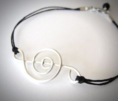 Sterling Treble Clef #bracelet on linen from JewelryByMaeBee on #Etsy.