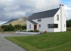 Sea Meadow | Ireland Co. Mayo Connacht. Minimalist calm pervades this sleek space - designed with the majestic surroundings in mind. Big groups can spread to the cottage next door