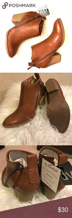 DV by Dolce Vita Jameson Cognac Women's Booties 6½ DV by Dolce Vita Jameson Cognac Women's Booties 6½   • Brand: DV by Dolce Vita • Style: Jameson  • Color: Cognac (Leather Luggage Brown) • Gender: Women's  • Condition: New, Unworn with Tags in Box 📦 👢 • UPC: 490961028043 • Made in China 🇨🇳   #dvbydolcevita #dolcevita #jameson #cognac #brown #fauxleather #zippers #wedges #ankleboots #anklebooties #size6.5 #nwt DV by Dolce Vita Shoes Ankle Boots & Booties
