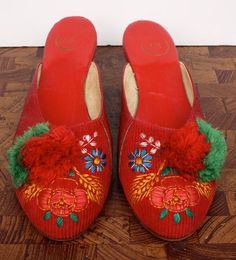 Red leather and corduroy Hungarian Szeged slipper shoes with embroidered flowers and pom-poms. Popular Art, Arte Popular, Hungarian Dance, Pom Pom Slippers, Hungarian Embroidery, Top To Toe, Folk Dance, Beautiful Costumes, Embroidered Flowers