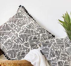 Lines in Black Throw Cushion with Black Pom Pom Trim (35.00 USD) by ZanaProducts