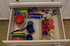 Toddler storage. I love this idea for all the cups, lids and containers.