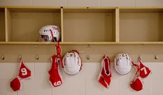 Hockey helmets and uniforms, which provide little coverage on the field, hang in the locker room before the Omaha Heart's opening game against the Atlanta Steam. The Legends Football League, formerly the Lingerie Football League, has moved away from the implications of its former name, though the uniforms remain scant. By: ALYSSA SCHUKAR/THE WORLD-HERALD