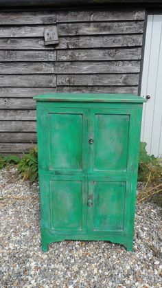 An oak four cupboard door cabinet painted with duck egg blue, Antibes Green and Florence. www.at-the-cartshed.co.uk