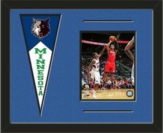 One framed 8 x 10 inch Minnesota Timberwolves photo of your choice with a Minnesota Timberwolves mini felt banner, double matted in team colors to 20 x 16 inches.  The lines show the bottom mat color.  (Pennant design subject to change)  $79.99 @ ArtandMore.com