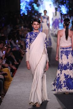 Models wearing pearly white saree with full embroidered blouse sashaying down the ramp,need we say more ?