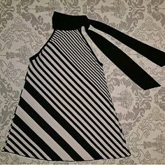 Charlotte Russe Striped Top with Tie Sleeveless black and white diagnol striped top from Charlotte Russe - High collar neckline with black tie straps - Smooth, stretchy fabric - 94% Polyester, 6% spandex - Worn many times, still in great condition! Charlotte Russe Tops
