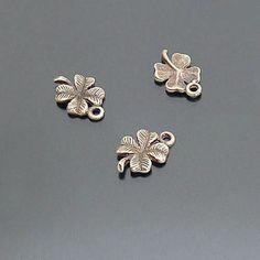 Lot of 20pcs Clover Four Leaf Charms Pendant Drop Antiqued Bronze SB63. $2,50, via Etsy.