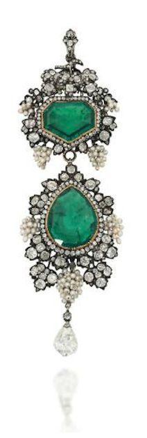 A LATE 19TH / EARLY 20TH CENTURY EMERALD AND DIAMOND BROOCH / PENDANT The surmount with fancy-cut emerald and single-cut diamond cluster centre, to a fruiting vine surround, composed of bunches of seed pearl grapes among old-cut diamond-set vine leaves, suspending a pear shaped emerald drop with similarly-set seed pearl and diamond border, to a further briolette-cut diamond terminal, mounted in silver and gold, 10.7cm long, later fitted retailers case