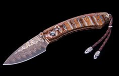 William Henry Limited Edition B09 Copper Creek Knife. The Kestrel 'Copper Creek' features a beautiful frame in 'Wave Mokume', inlaid with 10,000 year-old fossil Woolly Mammoth tooth. The blade is copper 'Wave' damascus with a core in VG-5; the one-hand button lock and the thumb stud are set with citrine. The blade is 'Hornets Nest' damascus by Mike Norris; the one-hand button lock and the thumb stud are set with spinel.  -- on ScrimshawGallery.com #WilliamHenry #knife