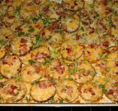 Loaded Baked Potato Rounds....4 large baking potatoes, cut into 1/2 inch slices (I used Russet and Yukon)  1/4 cup melted butter  salt and pepper to taste  2 TBL crushed garlic  8 slices bacon, cooked and crumbled  8 ounces shredded Cheddar cheese  1/2 cup chopped green onions  sour cream