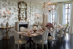 The elegant formal dining room features a metallic wall covering.