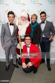 Gianluca Ginoble Piero Barone and Ignazio Boschetto of IL Volo pose with Santa Claus and assistant Vice President of Santa Monica Place Julia Ladd...
