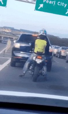A very cheerful motorcyclist caught on the road