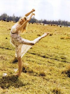 this would be me... just dancing alone in a field with some cows in the background. yes!