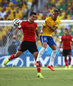 Mexico Holds Brazil To 0-0 Tie In World Cup Thriller. Yes, A Scoreless Thriller - FORTALEZA, BRAZIL - JUNE 17: Neymar of Brazil and Rafael Marquez of Mexico compete for the ball during the 2014 FIFA World Cup Brazil Group A match between Brazil and Mexico at Castelao on June 17, 2014 in Fortaleza, Brazil. (Photo by Robert Cianflone/Getty Images)