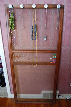 DIY Jewelry Organizer - Made from .20 knobs and an old screen door!
