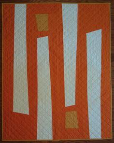 Modern baby quilt in orange and cream