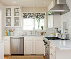 Kitchen, : Graceful Design Ideas Of Perfect Kitchen Colors Using Rectangular Silver Range Hood And White Tile Backsplash Also With L Shaped White Wooden Cabinets And Grey Floral Roman Shades Along With Silver Widespread Single Faucet And Rectangular Brown Rugs