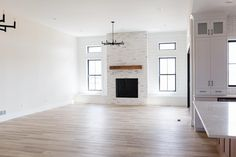 Exclusive Open Concept 2-Bed New American Farmhouse with Home Office - 365005PED | Architectural Designs - House Plans White Built Ins, Black Kitchen Island, American Farmhouse, Open Concept Floor Plans, The Gables, Home Room Design, Walk In Pantry, Great Rooms, House Plans