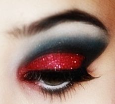 Red glitter eye shadow with black for crease and white for highlight.