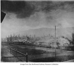 October 2014 - Another image from the Northwest Railway Museum Collection in honor of American Archives Month this month! Train hauling logs past railway depot, Snoqualmie, ca. 1895.