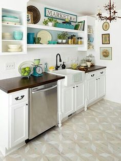 Crisp white kitchen with teal/turquoise accents. Lovely