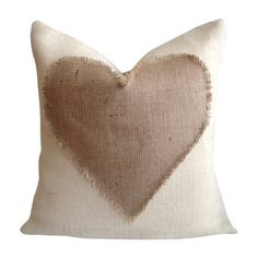 Eco-friendly and made in the USA, this chic burlap pillow features a fringed heart detail and a plush feather-down fill.  Product: