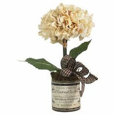 "Create a lush tablescape or charming vignette with this lovely faux hydrangea topiary, showcasing a charming gingham ribbon and French-typographic motif pot.  Product: Faux topiaryConstruction Material: Silk, plastic and glassColor: Cream, green and blackFeatures:  Includes faux hydrangeasGingham ribbon   HandmadeSuitable for indoor use only   Dimensions: 14"" H x 10.5"" W x 12.5"" D"
