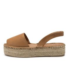Ibizas Espadrille Camel Sandal handcrafted by artisans in Spain. Handcrafted Soft leather upper Recycled rubber sole. Sustainable sandal for summer and other seasons.