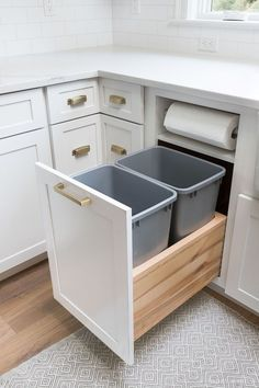 Storage & Organization Ideas From Our New Kitchen! Kitchen garbage pull-out with built-in paper towel holder - a must-have for my kitchen renovation!Kitchen garbage pull-out with built-in paper towel holder - a must-have for my kitchen renovation! Kitchen Cabinet Organization, Kitchen Drawers, Storage Cabinets, Cabinet Ideas, Corner Drawers, Kitchen Cabinet Design, Kitchen Island Storage, Food Storage Organization, Kitchen Islands