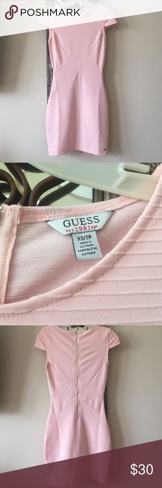 Guess dress! Baby pink. Wore this for a work party. Size xs. I am normally a small and it fit me perfect. I am 5'3 and it hit me a few inches above my knees. Super tight fitting and beautiful on. Perfect condition :) only worn once. Last picture is of it on, sorry for the black and white it's the only one I have! Guess Dresses Mini