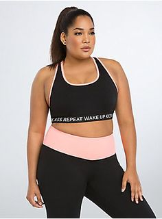 "<p>Who says workout wear can't be killer fashion? We say look hot and move with comfort no matter what. Sexy. Edgy. Go for it. <b>Torrid Active - performance with attitude.</b></p>  <p> </p>  <p>Need some workout motivation? ""Wake Up. Kick Ass. Repeat."" This layered, 4-way stretch sports bra maintains shape, while the inspirational bust band holds you in. Wicking technology keeps you cool and dry. Flat seams guarantee comfort. Coral trim lends a pop of color.</p>  <p>&nb..."