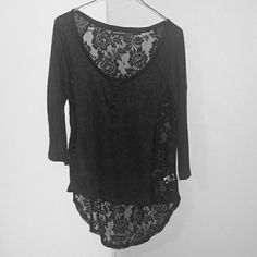 Black shirt w/ lace back Never worn, was a gift but too small for me. Tops