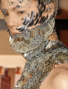 Alexander McQueen what is this?  a choker?,  a necklace?  a hat? One sure thing, it is not flattering, elegant or classy!!