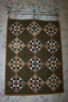 Bittersweet Stars.  A miniature quilt I made in Jo Morton's Little Women's Club last year.   I love, love, love the miniature quilts!