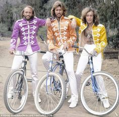 We don't know if those white trousers would stay white for long but the Bee Gees still look cool on their bikes!