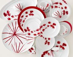 A spray of Japanese maple leaves in deep red on crisp white arc across the Pure Red Dinnerware Collection from Mikasa. Bold and exotic, this vibrant fine china boasts rich color and graceful shapes that create a dramatic tablescape.