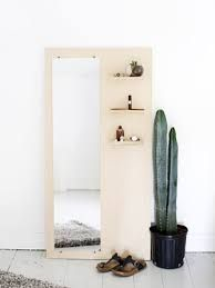 Mirror on a wood with shelves