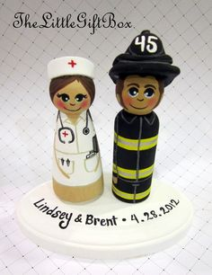 Wedding Cake Topper / Custom Painted Wood Peg Dolls with Plaque/ Fireman / Nurse. $61.95, via Etsy.