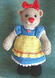 Bearalyn McRaggle Amigurumi ~ Free Download Pattern The pattern includes the jointed bear (cotter pin and disk-jointed neck, and thread-jointed limbs - instructions included) with incorporated shoes and striped stockings, dress with attached apron, bloomers, and hair bow.