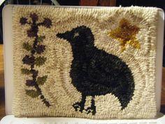 Primitive hooked rug on Esty.